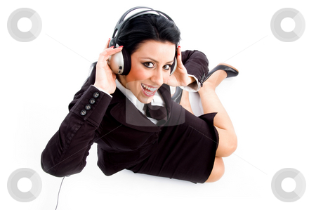 Young businesswoman wearing headphone stock photo, Young businesswoman wearing headphone against white background by Imagery Majestic