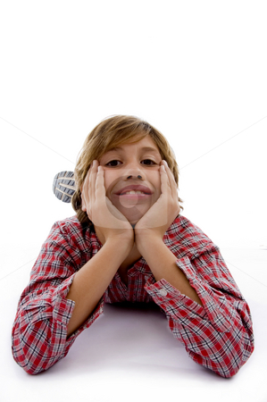 Front view of little child looking at camera stock photo, Front view of little child looking at camera with white background by Imagery Majestic