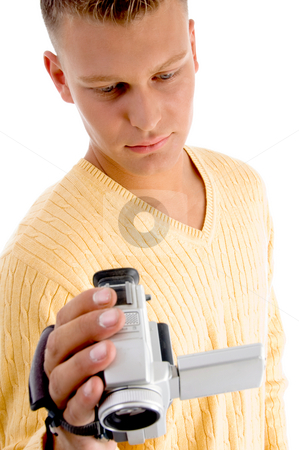Male operating video camera stock photo, Male operating video camera with white background by Imagery Majestic