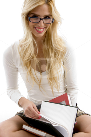 Front view of happy high school student with her books stock photo, Front view of happy high school student with her books with white background by Imagery Majestic