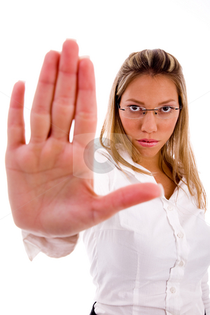 Front view of businesswoman showing stopping gesture stock photo, Front view of businesswoman showing stopping gesture on an isolated background by Imagery Majestic