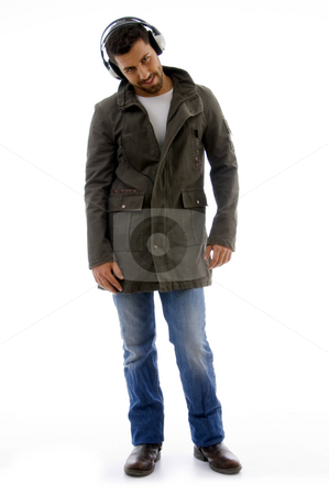 Full body pose of man listening to music  stock photo, L body pose of man listening to music on an isolated white background by Imagery Majestic