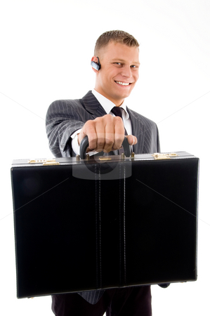 Young corporate showing his briefcase stock photo, Young corporate showing his briefcase with white background by Imagery Majestic