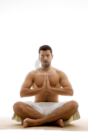 Front view of man practicing yoga  stock photo, Front view of man practicing yoga against white background by Imagery Majestic