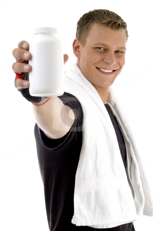 Pleased man showing bottle stock photo, Pleased man showing bottle on an isolated white background by Imagery Majestic