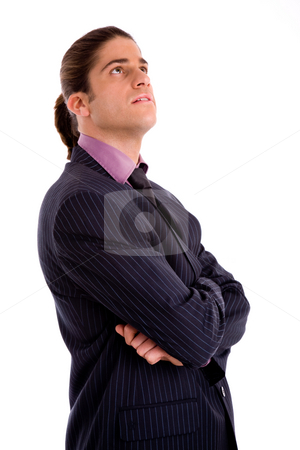 Side view of young executive looking up stock photo, Side view of young executive looking up on an isolated background by Imagery Majestic