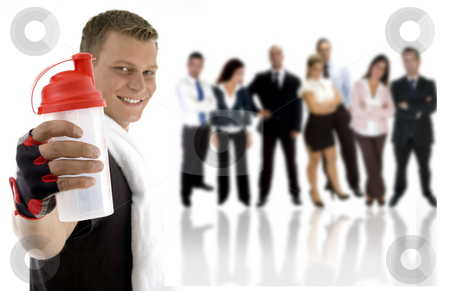 Young excersier and professional young people stock photo, Young excersier with a shaker bottle and professional young people in the background by Imagery Majestic