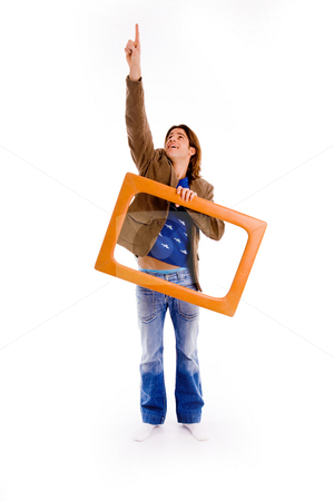 Front view of pointing man carrying frame stock photo, Front view of pointing man carrying frame on an isolated background by Imagery Majestic