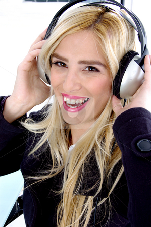 Side view of smiling woman listening music stock photo, Side view of smiling woman listening music by Imagery Majestic