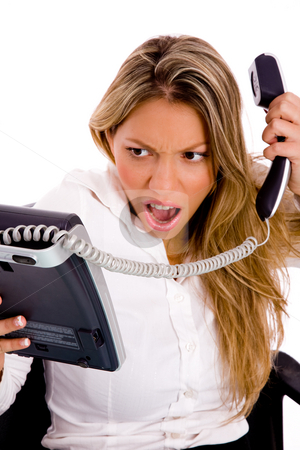 Front view of angry woman holding phone stock photo, Front view of angry woman holding phone against white background by Imagery Majestic