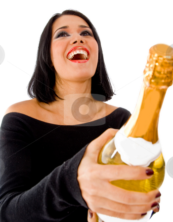 Front view of happy model holding champagne bottle stock photo, Front view of happy model holding champagne bottle on an isolated background by Imagery Majestic