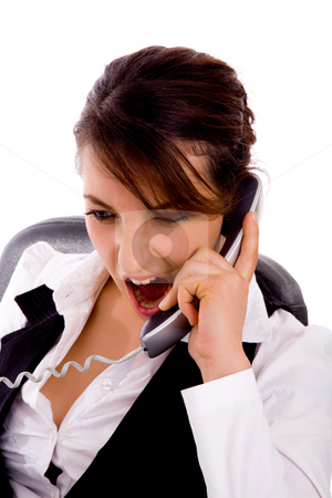 Front view of angry young businesswoman on call stock photo, Front view of angry young businesswoman on call against white background by Imagery Majestic