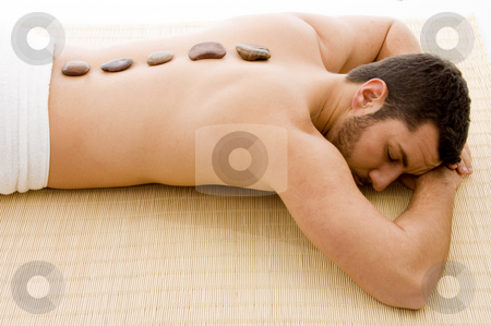 High angle view of man lying down on mat at spa  stock photo, High angle view of man lying down on mat at spa by Imagery Majestic