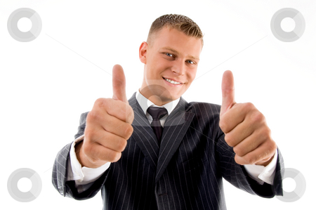 Smiling handsome lawyer showing thumbs up with both hands stock photo, Smiling handsome lawyer showing thumbs up with both hands on an isolated background by Imagery Majestic