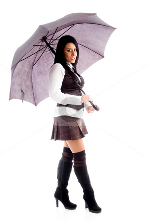Full body pose of young woman holding an umbrella stock photo, Full body pose of young woman holding an umbrella on an isolated white background by Imagery Majestic