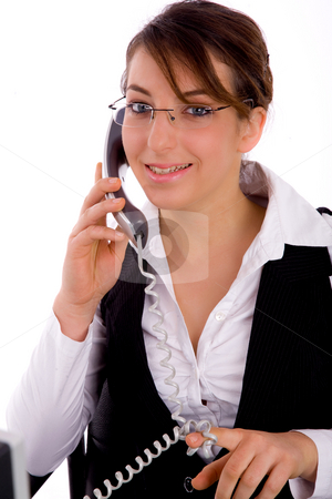 Front view of happy female lawyer communicating on phone stock photo, Front view of happy female lawyer communicating on phone with white background by Imagery Majestic