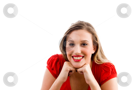 Female model posing with her chin on fists stock photo, Female model posing with her chin on fists on an isolated white background by Imagery Majestic