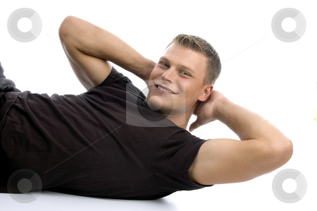 Man doing crunches stock photo, Man doing crunches on an isolated white background by Imagery Majestic