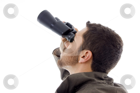 Side view of hispanic man looking through binoculars stock photo, Side view of hispanic man looking through binoculars on an isolated white background by Imagery Majestic