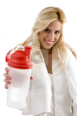 Portrait of smiling woman holding water bottle stock photo, Portrait of smiling woman holding water bottle against white background by Imagery Majestic