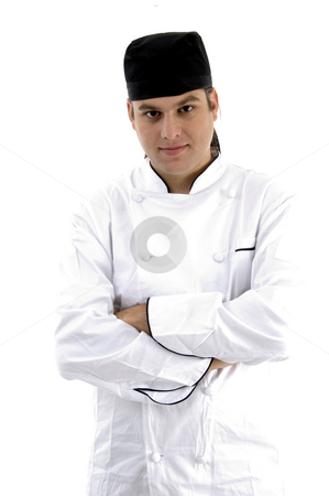 Portrait of chef posing in uniform stock photo, Portrait of chef posing in uniform against white background by Imagery Majestic
