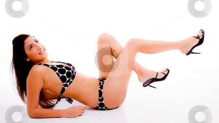 Side view of woman wearing bikini stock photo, Side view of sensuous woman looking up on an isolated background by Imagery Majestic