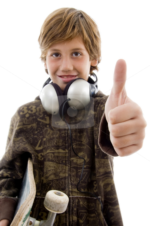 Front view of boy with headphone and thumbs up stock photo, Front view of ...