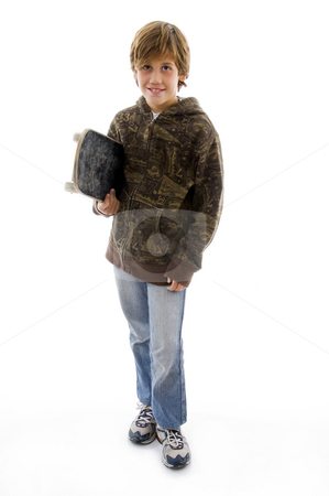 Front view of smiling boy with skateboard  stock photo, Front view of smiling boy with skateboard on an isolated white background by Imagery Majestic