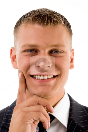 Portrait of handsome smiling businessman stock photo, Portrait of handsome smiling businessman on an isolated background by Imagery Majestic