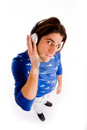 Top view of man listening to music stock photo, Top view of man listening music on an isolated white background by Imagery Majestic