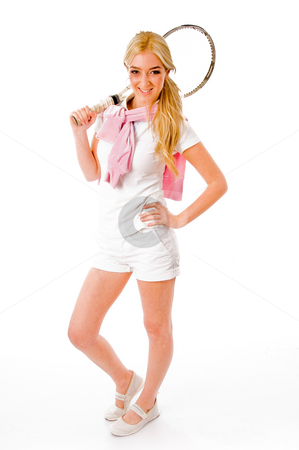 Front view of smiling tennis player holding racket stock photo, Front view of smiling tennis player holding racket on an isolated background by Imagery Majestic