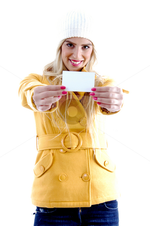 Front view of smiling woman showing business card stock photo, Front view of smiling woman showing business card against white background by Imagery Majestic