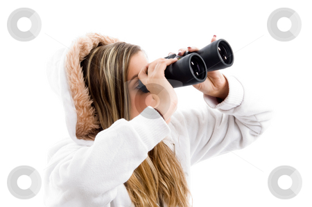 Young woman eyeing something with binoculars stock photo, Young woman eyeing something with binoculars with white background by Imagery Majestic