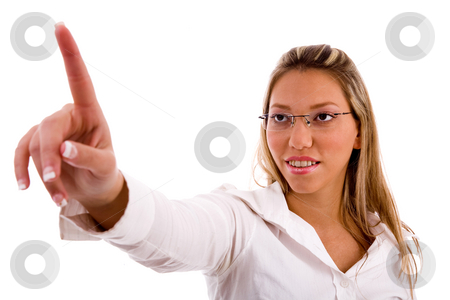 Portrait of businesswoman pointing up stock photo, Portrait of businesswoman pointing up with white background by Imagery Majestic