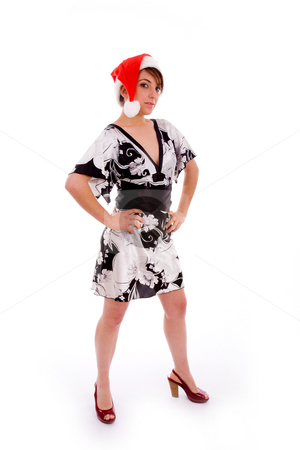 Full body pose of fashionable woman in christmas hat stock photo, Full body pose of fashionable woman in christmas hat on an isolated background by Imagery Majestic