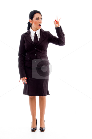 Standing ceo showing counting hand gesture stock photo, Standing ceo showing counting hand gesture with white background by Imagery Majestic