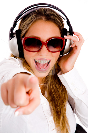 Front view of pointing female enjoying music stock photo, Front view of pointing female enjoying music on an isolated background by Imagery Majestic