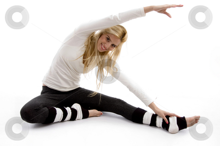 Front view of woman stretching  stock photo, Front view of woman stretching on an isolated white background by Imagery Majestic