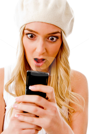 Portrait of surprised woman looking the cell phone stock photo, Portrait of surprised woman looking the cell phone with white background by Imagery Majestic