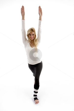Front view of smiling woman exercising stock photo, Front view of smiling woman exercising against white background by Imagery Majestic
