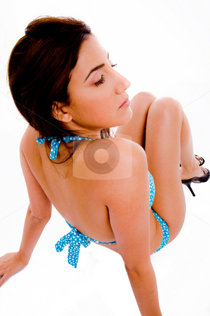 Top view of sitting sexy model in bikini stock photo, Top view of sitting sexy model in bikini with white background by Imagery Majestic