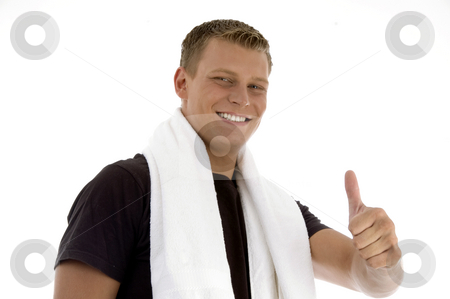 Smiling man showing thumb gesture stock photo, Smiling man showing thumb gesture on an isolated background by Imagery Majestic