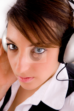 Female entrepreneur listening to music headphones stock photo, Closeup of female entrepreneur listening to music headphones by Imagery Majestic