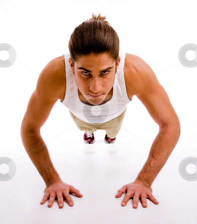 Front view of man doing pushups stock photo, Front view of man doing pushups on an isolated background by Imagery Majestic