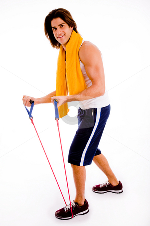 Man working out stock photo, Side view of man stretching rope on an isolated white background by Imagery Majestic