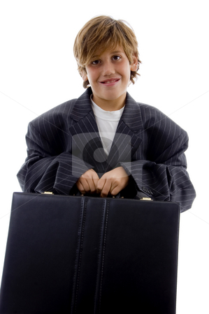 Front view of tired young businessman holding briefcase  stock photo, Front view of tired young businessman holding briefcase on an isolated background by Imagery Majestic
