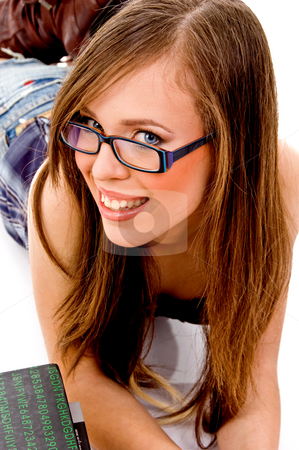Top view of smiling female looking at camera stock photo, Top view of smiling female looking at camera against white background by Imagery Majestic