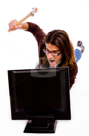 Front view of angry man striking monitor with hammer stock photo, Front view of angry man striking monitor with hammer on an isolated white background by Imagery Majestic
