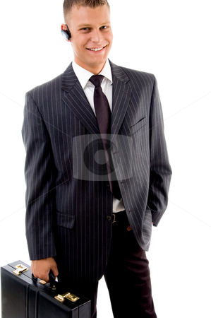 Portrait of businessman standing with briefcase stock photo, Portrait of businessman standing with briefcase on an isolated background by Imagery Majestic