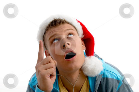 Pointing male with christmas hat stock photo, Pointing male with christmas hat on an isolated background by Imagery Majestic